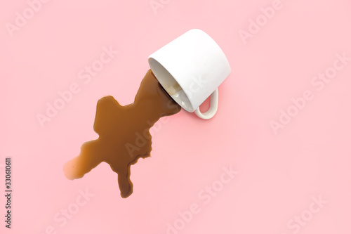 Fototapeta Overturned cup of coffee on color background obraz