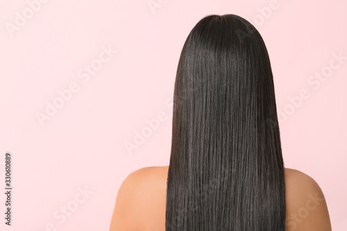 Obraz Young Asian woman with beautiful long hair on color background - fototapety do salonu