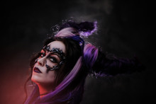 Close Up Photo Of A Mystic Young Girl In A Magic Creature Cosplay, Wearing Dark Banshee Make-up And Violet Horns, Looking Devil