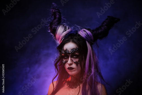 Close up photo of a mystic young girl in a magic creature cosplay, wearing dark Wallpaper Mural