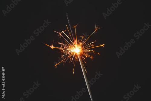 Obraz Beautiful Christmas sparkler on dark background - fototapety do salonu