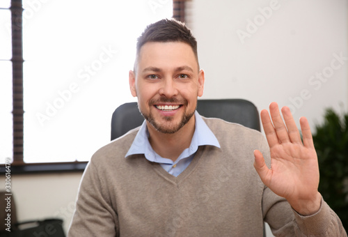 Man using video chat in office, view from web camera Tablou Canvas