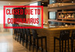 Defocused view of interior of an upmarket bar empty and closed due to coronavirus or covid-19