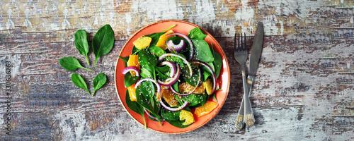 Fototapeta Green fresh detox salad with spinach and orange. Healthy food concept. Super food. obraz