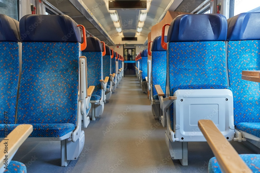 Fototapeta Interior of a passenger train with empty seats