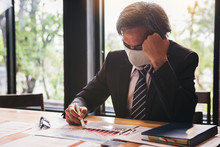 Bad Investment Or Economic Crisis From Virus Concept. Senior Businessman With The Mask Is Disappointed And Seriously By Badbusiness Results Report From Virus Crisis Attack.