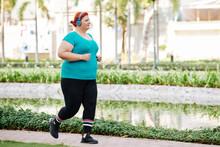 Overweight Woman Enjoying Runn...
