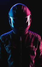 A Guy In A Motorcycle Helmet And Leather Jacket Against A Background Of Neon Lights And Smoke