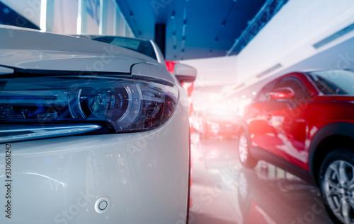Fotografía Closeup headlamp of white SUV car