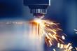 Leinwandbild Motiv CNC gas cutting metal sheet, sparks fly. Blue steel color, modern industrial technology