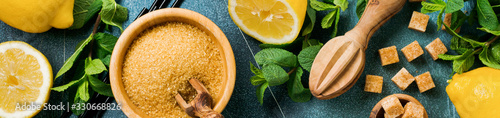 Obraz Concept with ingredients for homemade refreshing lemon juice lemonade, cane sugar, and mint on old concrete background. - fototapety do salonu