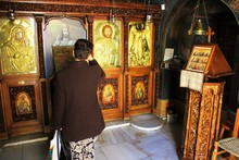 Pilgrims Praying Inside A Gree...
