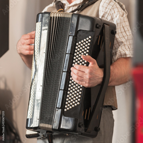 Live music background. Accordionist plays Wallpaper Mural