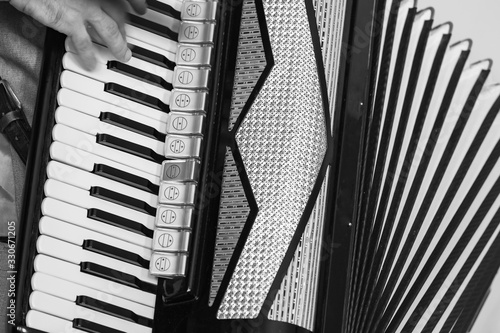 Accordionist plays vintage accordion. Black and white Wallpaper Mural