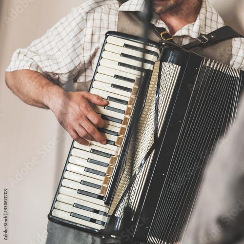 Accordionist plays vintage accordion Canvas Print