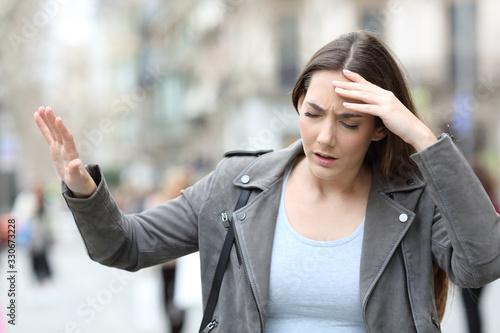 Obraz na plátně Dizzy woman feeling sick on street