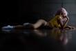 Leinwandbild Motiv Beautiful blode sexy woman lying on floor and sexy pose with perfect body shape,Nude Art Concept,Low Key