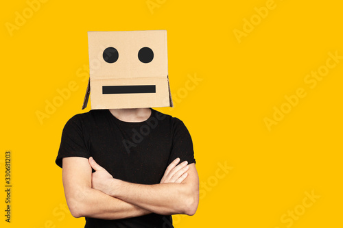 Portrait of an indifferent man with a box and cartoony emotions on his head Canvas Print