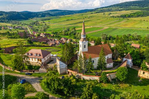 Deutsch Kreuz village Crit aerial view with fortified Church in Transylvania, Romania