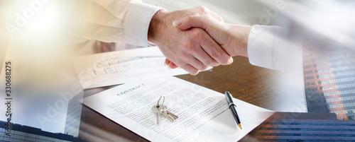 Estate agent shaking hands with his customer; multiple exposure Fototapeta
