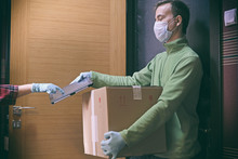 Courier In Protective Mask Del...
