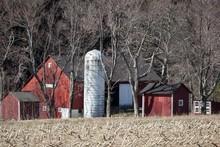 Old Barn And A Silo Between Ba...