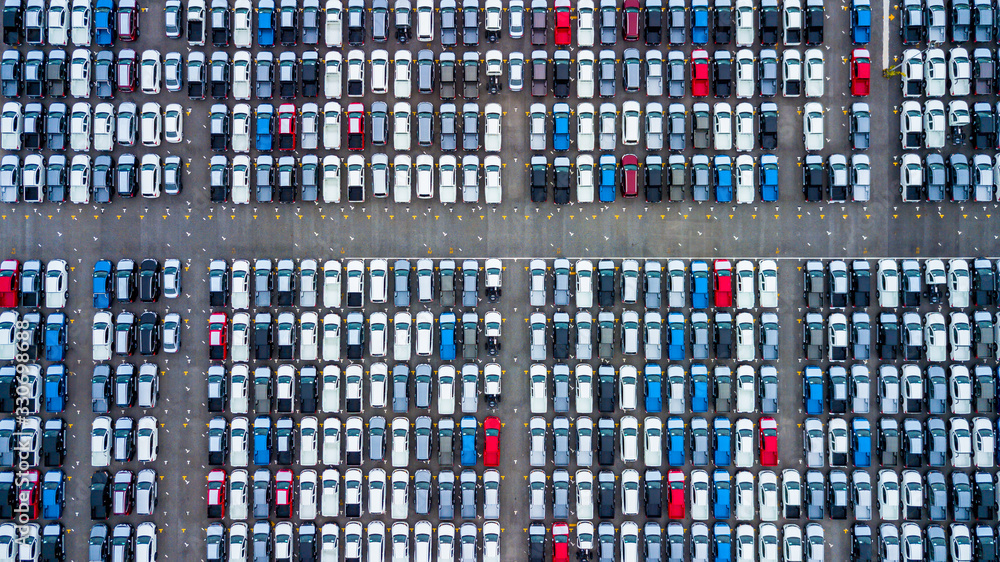 Fototapeta Aerial view new cars parking for sale stock lot row, New cars dealer inventory import export business commercial global, Automobile and automotive industry distribution logistic transport worldwide.