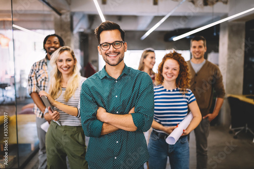 Group of successful business people designers architects in office