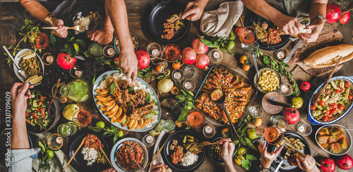 Flat-lay of family feasting with Turkish cuisine lamb chops, quince, bean, veget Fototapeta