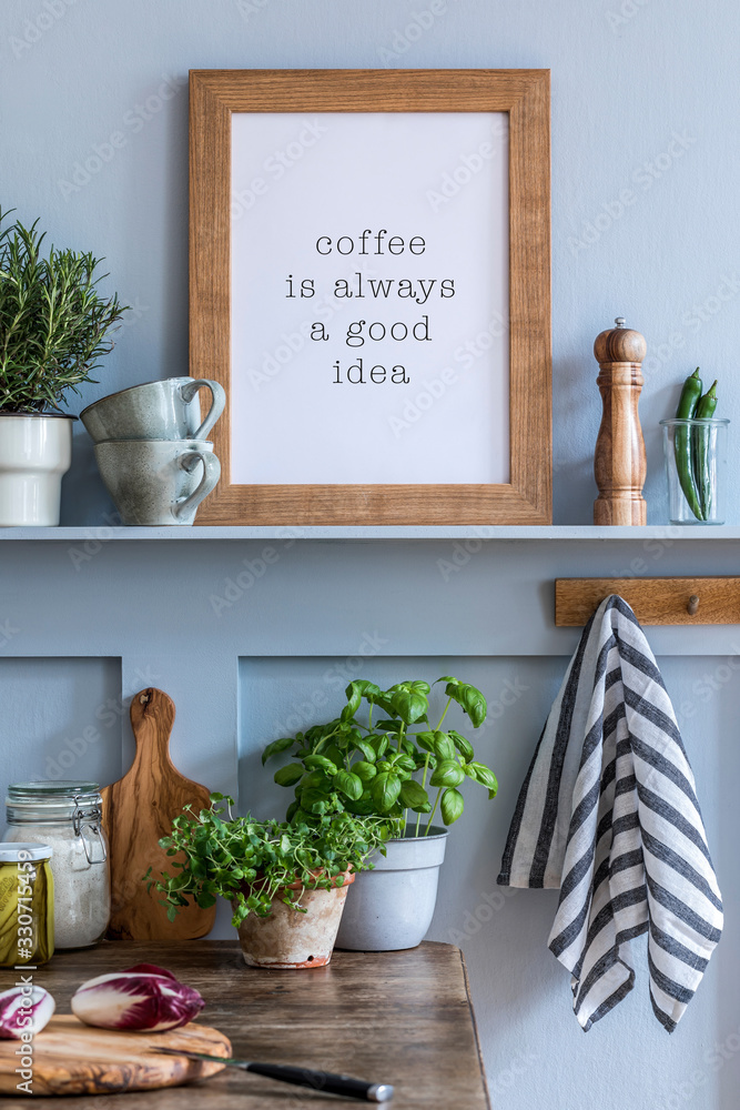 Fototapeta Interior design of kitchen space with mock up photo frame, wooden table, herbs, vegetables, food and kitchen accessories in modern home decor.