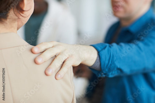 Fotografia, Obraz Close up of male hand on shoulder, people comforting each other in psychology su