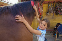 Summer Camp. Happy Girl Is Riding On The Horse
