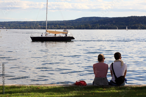 Vászonkép Angera (VA), Italy - September 15, 2016:  Tourist relaxing at Angera Lake, Angera, Maggiore Lake, Varese, Lombardy, Italy
