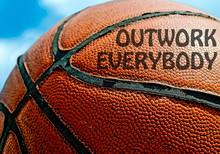 Outwork Everybody Written On An Orange Basketball