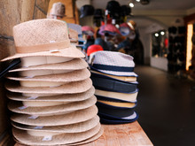 Close-up Of Stacked Hats At A Market
