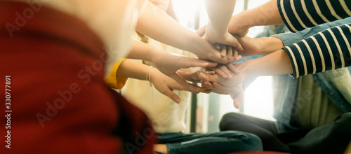 successful business achievement asian business friend colleagues hand join together for power handshake relation partners asian creative friend sit together and hand join for success inspiration team