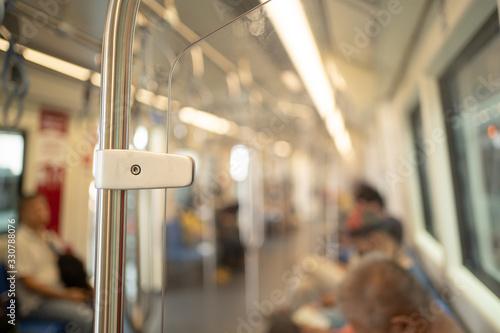 Obraz Inside the train. Focus on metal pole. - fototapety do salonu
