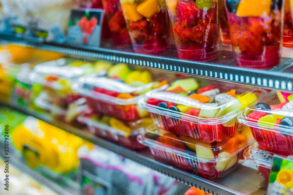 Fototapeta Packages with fruits displayed in a commercial refrigerator