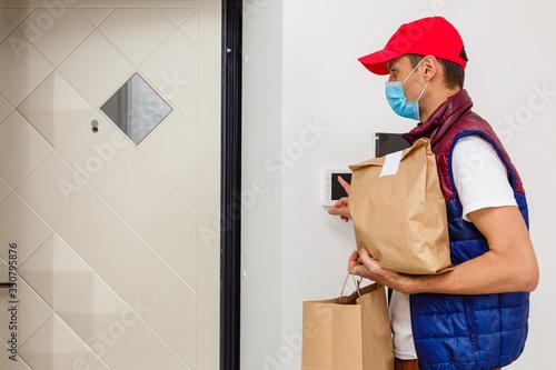 Obraz food delivery man Wearing Medical Mask. Corona Virus Concept - fototapety do salonu