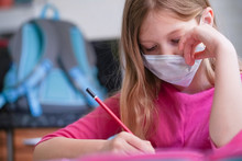 Coronavirus Home School Concept, Quarantine. Girl Doing Homework.