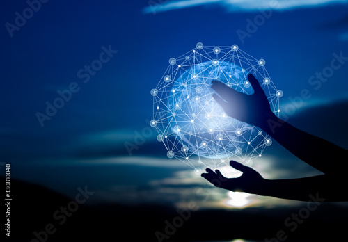 Fototapeta Abstract science, circle global network connection in hands on night sky background / Blue tone concept obraz