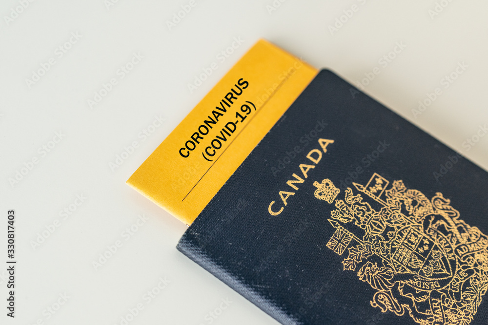 Fototapeta Coronavirus travel ban Canada passport with health certificate test proof of Corona virus free passenger tourists. Closure of airports restricted traveling.