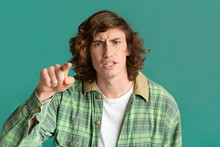 Frustrated Teenager Pointing Finger At You In Accusation On Color Background