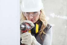 Woman Contruction Worker Using...