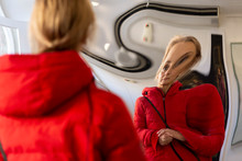 Woman Distorted In A Mirror
