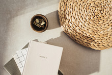 Flatlay Notebooks, Clips In Wooden Bowl, Straw Stand On Beige Concrete Background. Office Desk Workspace. Business, Work Blank Template. Flat Lay, Top View.