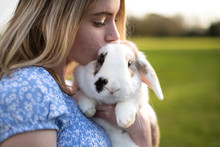 Young Girl Holding Her Pet Bunny