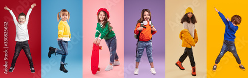 Obraz Cheerful multiracial little girls and boys against vibrant background - fototapety do salonu