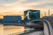 beautiful panoramic view at sunset, Berlin Spreebogen at Hugo-Preuss Bridge with a view of the Cube Berlin and John F. Kennedy House building at the main train station and the river Spree