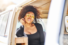 Edgy African American Model Posing In Vintage Vehicle Interior
